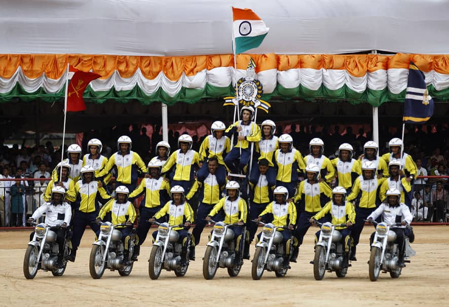 A group of Indian army personnel perform on motorcycles during a function to mark India`s Independence Day in Bangalore.
