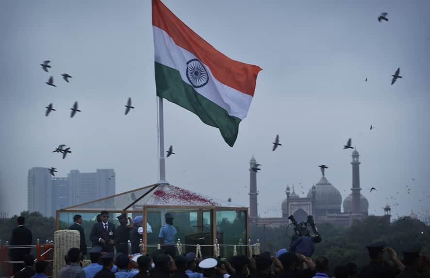 Prime Minister Manmohan Singh unfurls the Indian tricolor from the ramparts of Red Fort to celebrate Independence Day, in New Delhi.
