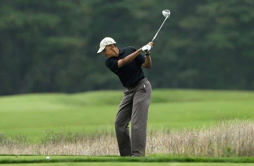 President Barack Obama golfs at Vineyard Golf Club in Edgartown, Mass., on the island of Martha`s Vineyard.