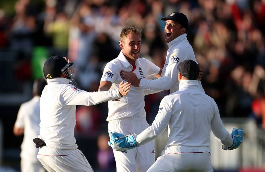 England`s Stuart Broad, center, celebrates defeating Australia during the fourth day of the fourth Ashes series cricket match at the Riverside cricket ground, Chester-le-Street, England.
