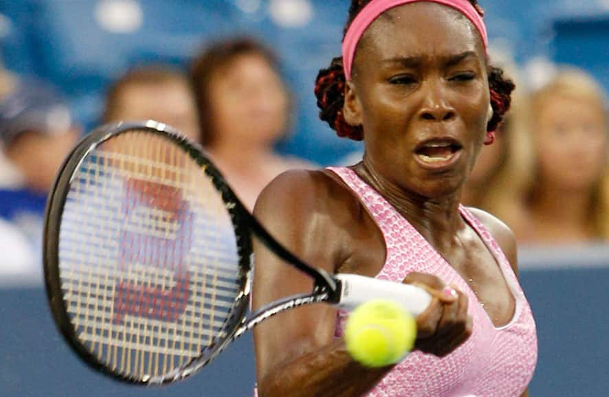 Venus Williams, from the United States, returns to Jana Cepelova, from Slovakia, during a match at the Western & Southern Open tennis tournament in Mason, Ohio.