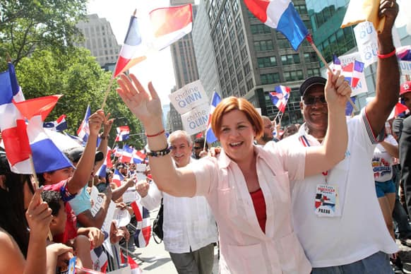 Christine Quinn, running in the New York City Mayors race, center, interacts with the crowd as she makes her way up New York`s Avenue of the Americas during the Dominican Day Parade.