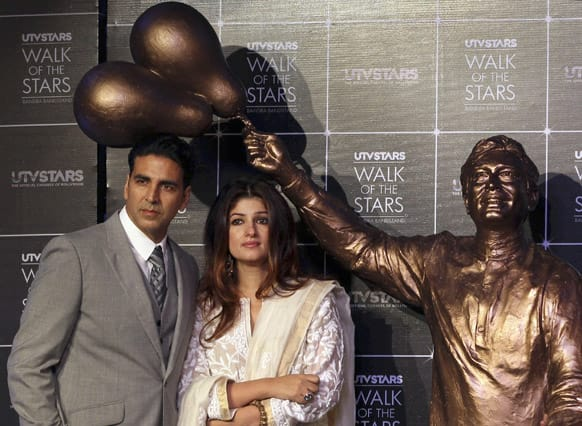Former Bollywood actress Twinkle Khanna and her husband Akshay Kumar attend the unveiling of a statue of her father and Bollywood superstar Rajesh Khanna in Mumbai.