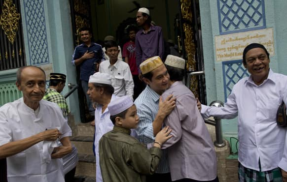 Myanmar Muslims greet each other after offering prayer to mark the celebration of Eid al-Fitr, the end of holy fasting month of Ramadan in Yangon, Myanmar.