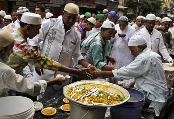 Indian Muslims buy sweets after offering Eid al-Fitr prayers in Kolkata.