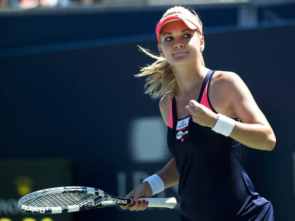 Agnieszka Radwanska of Poland reacts after defeating Sara Errani of Italy during the quarter final of the Rogers Cup women`s tennis tournament, in Toronto.