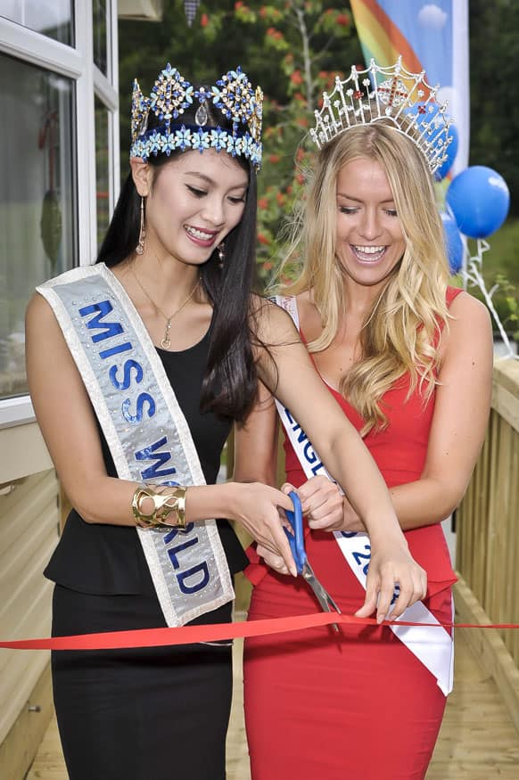 Miss World, Yu Wenxia of China and Miss England, Kirsty Heslewood cut a ribbon to officially open a new holiday home caravan at the Finlake Holiday Park, south west England.