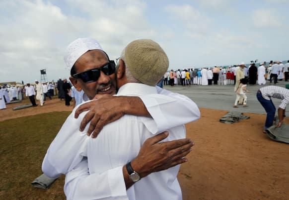 Sri Lankan Muslims embrace each other as they celebrate Eid al-Fitr in Colombo.