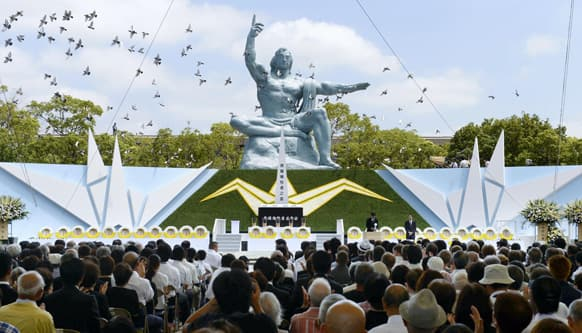 Doves fly during a ceremony to mark the 68th anniversary of the world`s second atomic bomb attack over the city, at Nagasaki Peace Park in Nagasaki, southern Japan.