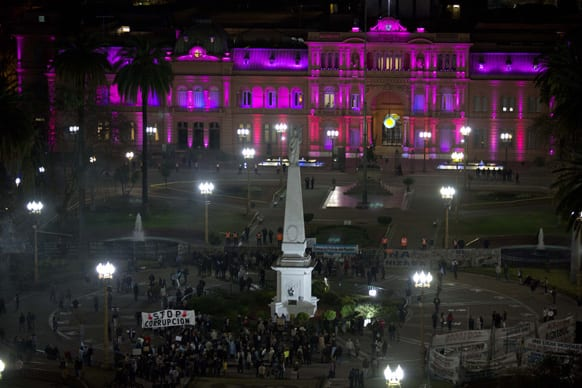 A group of demonstrators gather in Plaza de Mayo to protest the government of Argentina`s President Cristina Fernandez outside the Casa Rosada presidential office in Buenos Aires, Argentina.