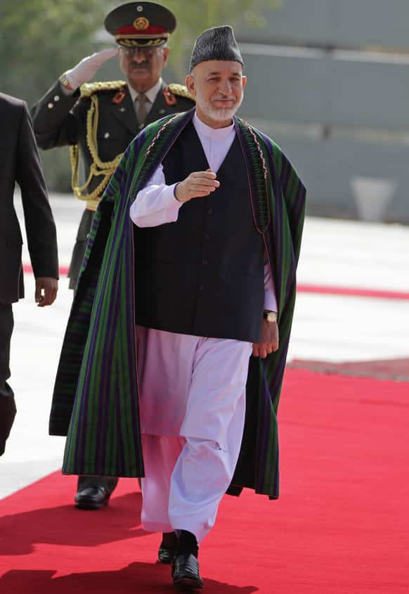 Afghan President Hamid Karzai arrives for Eid al-Fitr prayer that marks the end of the Muslim holy month of Ramadan in Kabul.