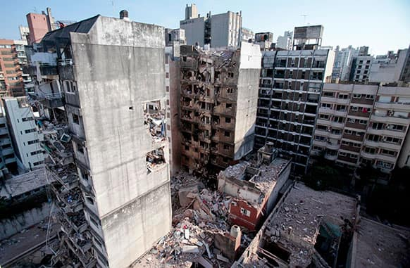 This view shows two other towers, in front of and behind a 10-story apartment building destroyed by a Tuesday gas explosion that killed 10 people, in Rosario, Argentina.