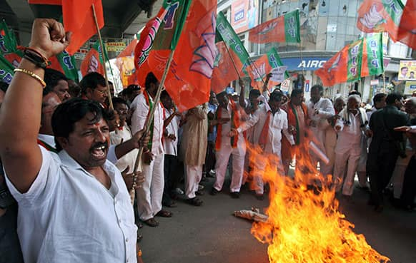 Activists of All India Youth Congress burn an effigy of Pakistan's spy service, Inter Services Intelligence (ISI) during a protest against the death of five Indian army soldiers in cross-border exchanges, in Hyderabad.