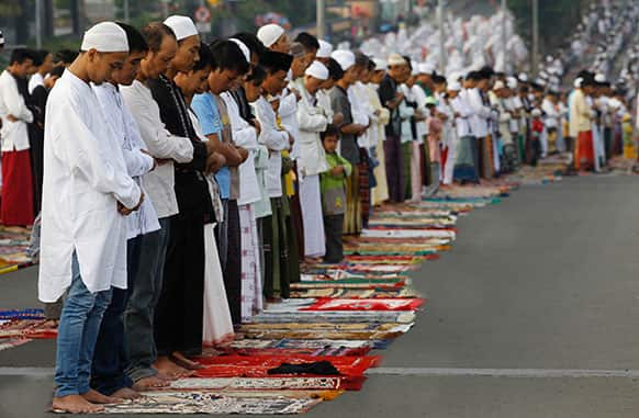 Muslims offer Eid al-Fitr prayers that marks the end of the holy fasting month of Ramadan in Jakarta, Indonesia.