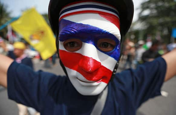 An anti-government protester joins protest march against an amnesty bill in Bangkok, Thailand.