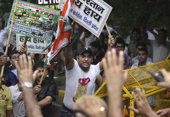 Activists of Congress party`s youth wing shout slogans during a protest against the death of five Indian army soldiers in cross-border exchanges, New Delhi.