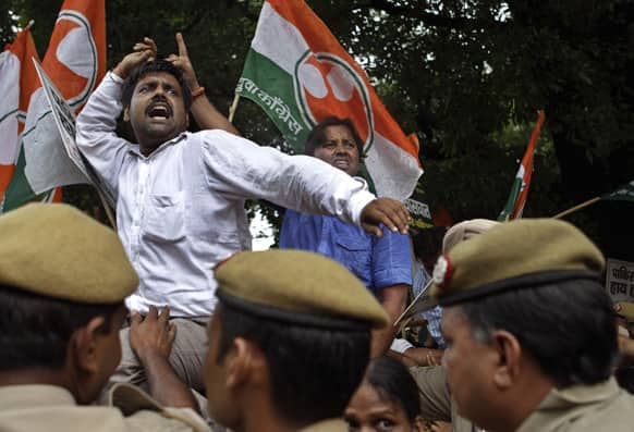 Activists of India`s Congress party`s youth wing shout slogans during a protest against the death of five Indian army soldiers in cross-border exchanges, New Delhi.