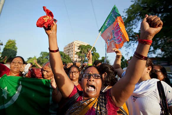 An activist of India's main opposition Bharatiya Janata Party (BJP) shouts slogans during a protest against the death of five Indian army soldiers in cross-border exchanges, in Allahabad.