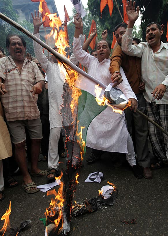 Activists of the Indian right-wing Hindu organization Shiv Sena shout slogans as they burn a Pakistani flag during a protest against the death of five Indian army soldiers in cross-border exchanges, in Jammu.