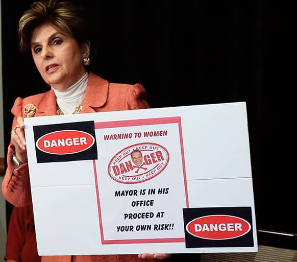 Attorney Gloria Allred holds a sign alluding to San Diego Mayor Bob Filner during a news conference in San Diego.
