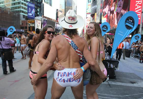 Robert John Burck, also known as the Naked Cowboy and two unidentified women are seen at the 11th annual national Underwear Day in New York.