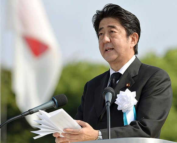 Japan`s Prime Minister Shinzo Abe delivers his speech at the Hiroshima Peace Memorial Park during the ceremony to mark the 68th anniversary of the atomic bombing of Hiroshima, western Japan.