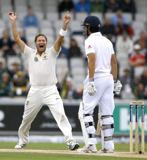 Australia`s Ryan Harris, celebrates the wicket of England`s captain Alastair Cook, right, during day five of the third Ashes Test match held at Old Trafford cricket ground in Manchester, England.