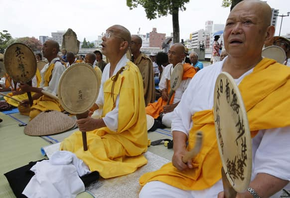 Buddhist monks chant a Buddhist mantra while beating drums in front of the Atomic Bomb Dome in Hiroshima, western Japan.