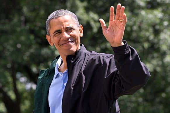President Barack Obama waves to the media as he walks on the South Lawn of the White House in Washington after returning on Marine One from Camp David, Md., where he spent his birthday.