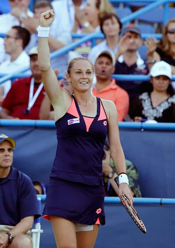Magdalena Rybarikova, from Slovakia, celebrates after a point during a finals match against Andrea Petkovic, from Germany, at the Citi Open tennis tournament.