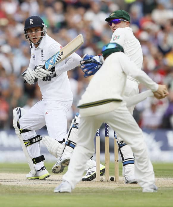 England`s Stuart Broad plays a shot off the bowling of Australia`s Nathan Lyon during day four of the third Ashes Test match held at Old Trafford cricket ground in Manchester, England.