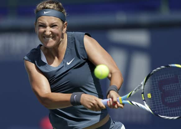 Victoria Azarenka, of Belarus, returns a serve from Ana Ivanovic, of Serbia, during their semifinal match of the Southern California Open tennis tournament.