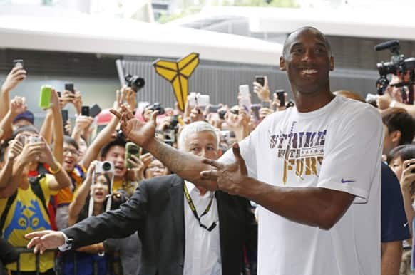 NBA player Kobe Bryant poses with his fans during a promotional event in Hong Kong.