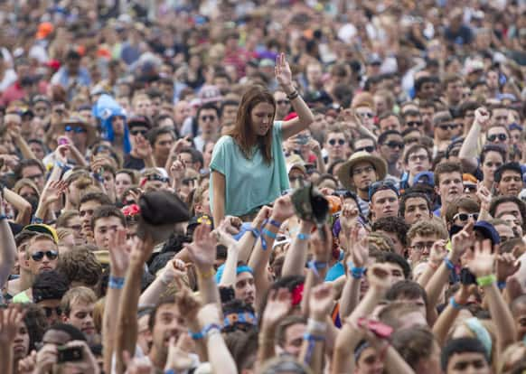 Fans watch Canadian electronic band Crystal Castles perform at Lollapalooza Festival in Chicago. The more than two-decade-old festival opens Friday in Chicago`s lakefront Grant Park.