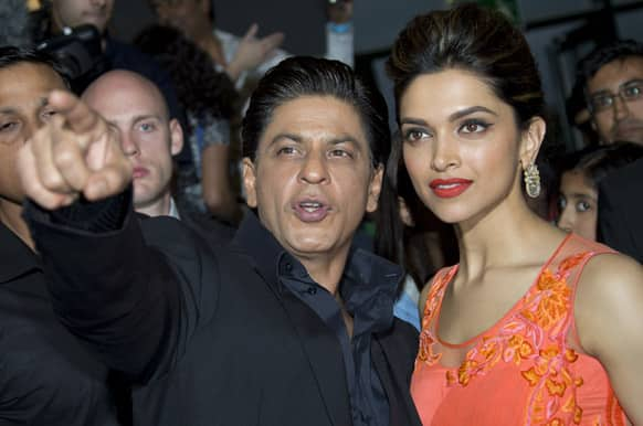 Bollywood actors Shah Rukh Khan and Deepika Padukone attend the UK Premiere of Chennai Express at a cinema in Feltham, England.