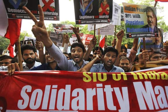 Students of various Indian universities shout slogans against Egyptian Defense Minister Gen. Abdel-Fattah el-Sissi and interim Vice President Mohamed ElBaradei during a solidarity march in support of Egypt`s ousted President Mohammed Morsi outside the Egyptian Embassy in New Delhi.