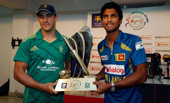 Sri Lanka`s captain Dinesh Chandimal, right, and his South African counterpart Faf du Plessis pose with the match trophy in Colombo, Sri Lanka.