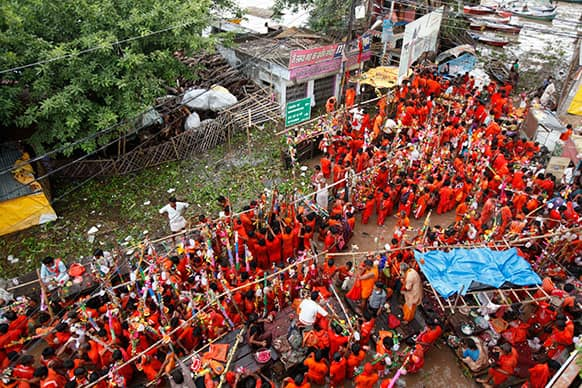 Hindu pilgrims, known as Kanwarias, gather for holy dips in the Ganges River in Allahabad.