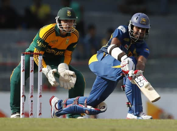 Sri Lankan batsman Lahiru Thirimanne, right, plays shot in front of South African wicketkeeper Quinton de Kock during their 5th one-day international (ODI) cricket match in Colombo, Sri Lanka.