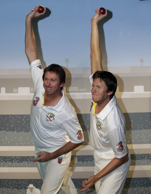 Former Australian cricket player Glenn McGrath, poses next to a wax statue of himself at Madame Tussauds in Sydney. McGrath was voted by the Australia public as their favorite sporting celebrity to be immortalized in wax.