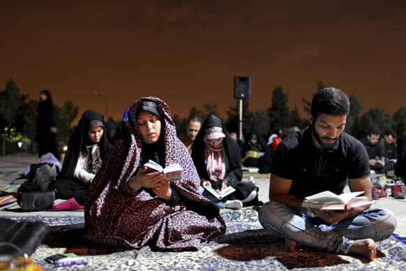 Iranians read Quran during a religious ceremony marking Imam Ali`s death at the Behesht-e-Zahra cemetery, just outside Tehran, Iran.