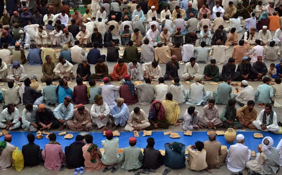 Pakistani Muslims wait for Iftar, breakfast in English, to break their dawn to dusk fast during Ramadan in Quetta, Pakistan.