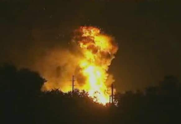 In this image taken from Associated Press video, flames rise from an explosion at the Blue Rhino propane plant in Tavares City, Fla.