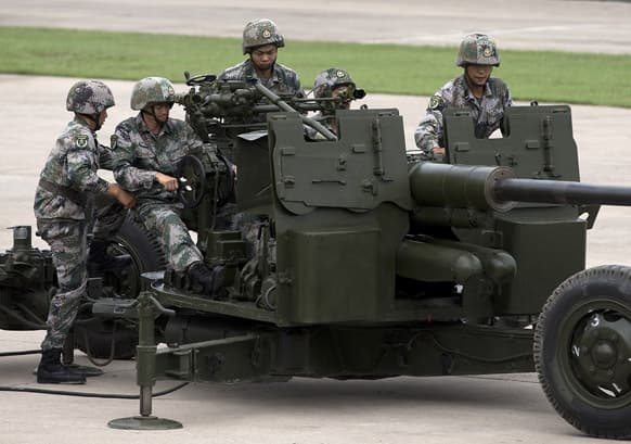Soldiers operate the PG59 57mm anti-aircraft artillery gun during a demonstration at a base of People's Liberation Army Lanzhou Military 47th Combined Corps anti-air brigade in Xi`an in northwest China`s Shaanxi province.