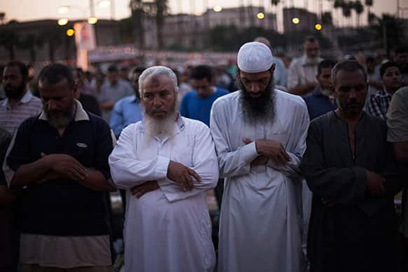 Supporters of Egypt`s ousted President Mohammed Morsi pray during a protest near Cairo University in Giza, Egypt.