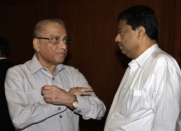 Indian cricket board`s interim president Jagmohan Dalmiya, left, talks with game development officer Ratnakar Shetty, prior to a meeting in Kolkata.