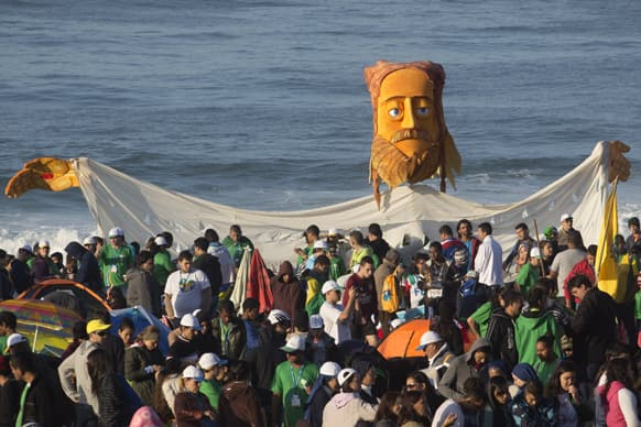 Pilgrims carry a large puppet representing Jesus as they wait for Pope Francis` arrival on Copacabana beach in Rio de Janeiro, Brazil.