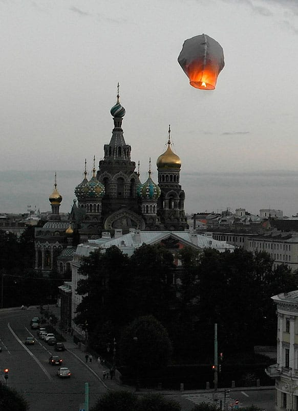 In this aerial photo a paper lantern flies over the Savior of Spilled Blood Cathedral in St. Petersburg, Russia.