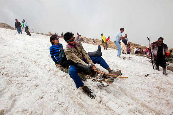 Indian tourists enjoy sledge ride in snow in Afarwat, Gulmarg, some 60 Kilometers (38 miles) west of Srinagar.