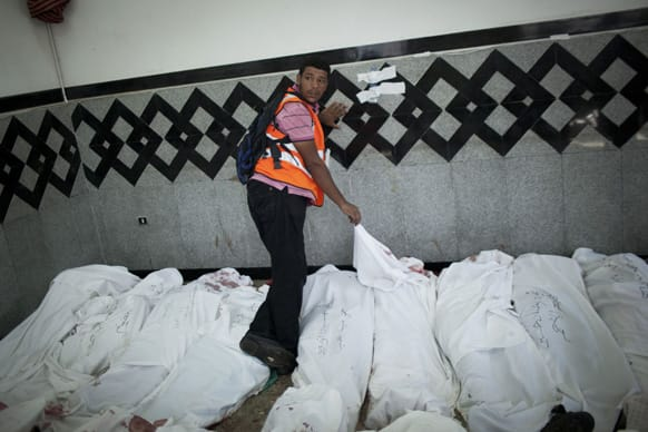 An Egyptian man identifies the body of a supporter of Egypt`s ousted President Mohammed Morsi injured who was killed in clashes with security forces at Nasr City, where pro-Morsi protesters have held a weeks-long sit-in, in a field hospital in Cairo, Egypt.